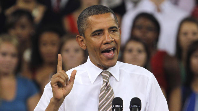 President Barack Obama gestures while speaking at North Carolina State University in Raleigh, N.C., Wednesday, Sept. 14, 2011, where he spoke about the American Jobs Act. (AP Photo/Gerry Broome)