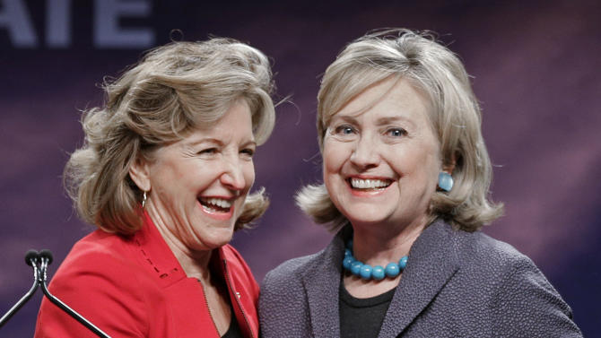 Former Secretary of State of State Hillary Rodham Clinton, right, stands with Sen. Kay Hagan (D-NC), on the stage during a campaign rally in Charlotte, N.C., Saturday, Oct. 25, 2014. Hagan is running for re-election against Republican candidate and North Carolina Speaker of the House Thom Tillis. (AP Photo/Chuck Burton)