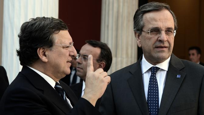 Greek Prime Minister Antonis Samaras, right, listens to European Commission President Jose Manuel Barroso during the take over ceremony of the six-month rotation of the Greek EU Presidency at Zappeion Hall in Athens, on Wednesday, Jan. 8, 2014. (AP Photo/Aris Messinis, Pool)