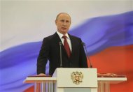 Putin is sworn in as the new Russian president during a ceremony at the Kremlin in Moscow