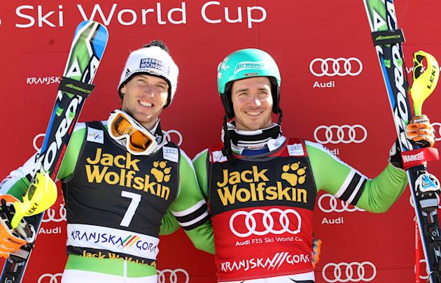 Germany's Felix Neureuther, right, stands on the podium next to second placed fellow-countryman Fritz Dopfer, after winning an alpine ski, men's World Cup slalom, in Kranjska Gora, Slovenia, S