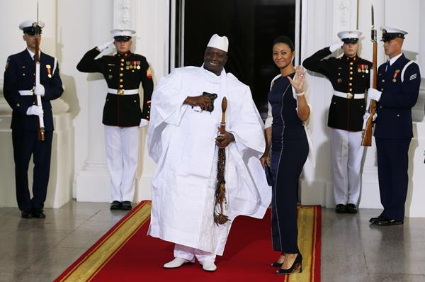 Republic of the Gambia's President Yahya Jammeh and his wife, Zineb Jammeh, arrive for the official U.S.-Africa Leaders Summit dinner hosted by U.S. P...
