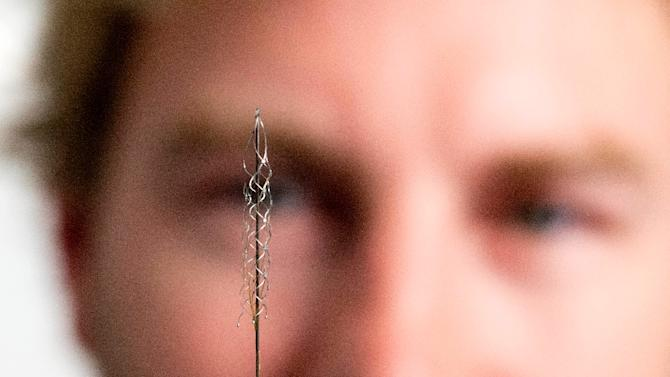 The tiny device that can read signals from the brain's motor cortex