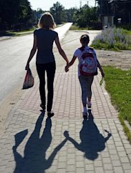 A child and her mother on their way to school on June 14, 2013 in Kuligow, Poland