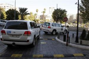 U.N. vehicles transport a team of U.N. chemical weapons experts in Damascus