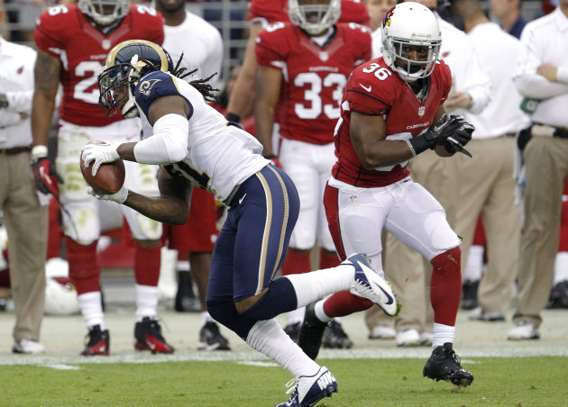 St. Louis Rams cornerback Janoris Jenkins (21) intercepts a pass intended for Arizona Cardinals running back LaRod Stephens-Howling (36) during the first half of an NFL football game, Sunday, Nov. 25,