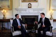 Britain's Prime Minister David Cameron (R) meets with United States Republican Presidential Nominee Mitt Romney at 10 Downing Street in London. Cameron insisted Thursday that Britain would deliver a memorable Olympics after Romney backtracked on barbed comments he made about the London Games
