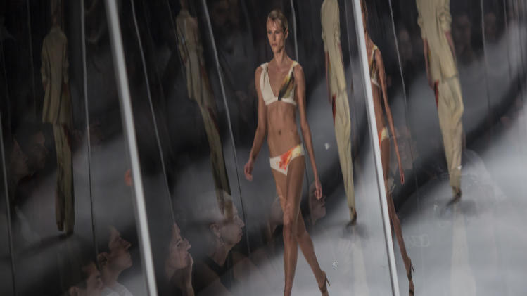 AP10ThingsToSee - People behind a transparent partition watch models wearing creations by Lenny Niemeyer during Fashion Week in Rio de Janeiro, Brazil, Friday, April 11, 2014. (AP Photo/Felipe Dana)