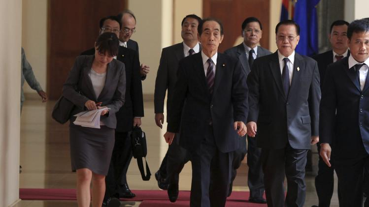 Japan's Upper House Vice-President Koshiishi arrives for a meeting with the president of the Cambodia's National Assembly in Phnom Penh
