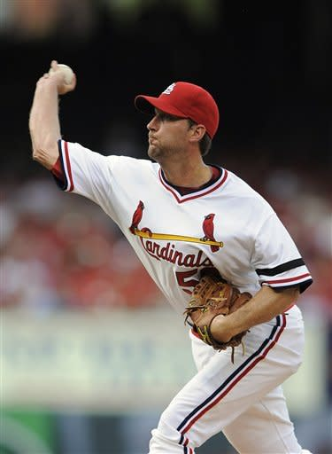 Wainwright's arm, bat lead Cardinals over Brewers