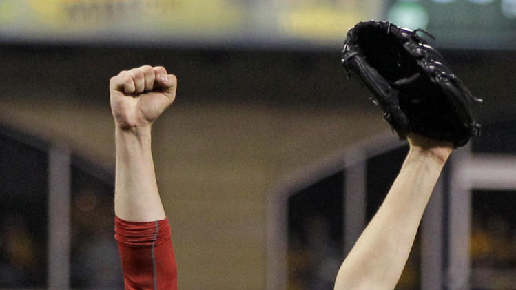Cincinnati Reds starting pitcher Homer Bailey (34) celebrates getting the final out of a no-hitter in a baseball game against the Pittsburgh Pirates in Pittsburgh Friday, Sept. 28, 2012. The Reds won 1-0.  (AP Photo/Gene J. Puskar)