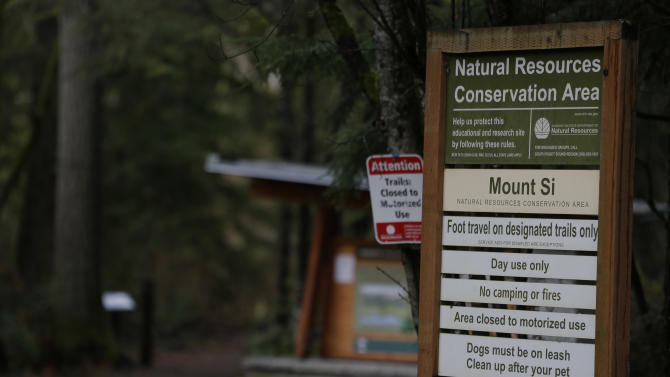 The trailhead of the route to the top of Mount Si is shown Friday, Jan. 4, 2013, near North Bend, Wash. Searchers in the air and on the ground were looking for 29-year-old Kurt Ruppert of Lake City, Fla., who has been missing since a skydiving trip on Thursday. (AP Photo/Ted S. Warren)