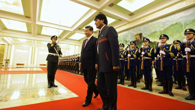 Bolivia's President Morales and China's President Xi attend a welcoming ceremony at the Great Hall of the People in Beijing