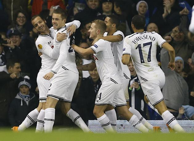 Tottenham's Roberto Soldado, left, celebrates with team mates after scoring a goal during the Europa League group K soccer match between Tottenham Hotspur and Anzhi Makhachkala at White Hart Lane