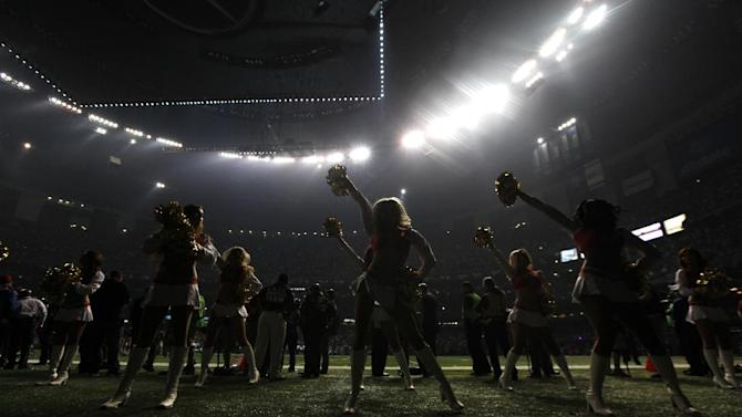 San Francisco 49ers cheerleaders perform during a power outage at the Superdome in the second half of the NFL Super Bowl XLVII football game between the 49ers and the Baltimore Ravens, Sunday, Feb. 3, 2013, in New Orleans. (AP Photo/Evan Vucci)