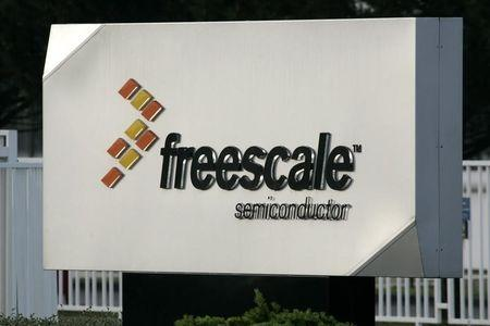 The logo of Freescale Semiconductor Inc is seen at the entrance of the plant in Toulouse