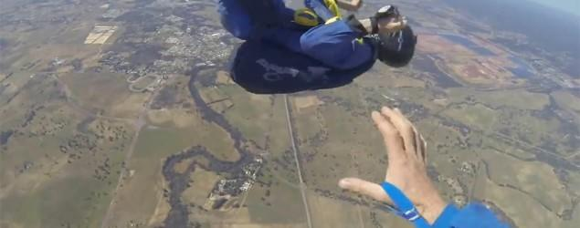 Plummeting skydiver saved by instructor