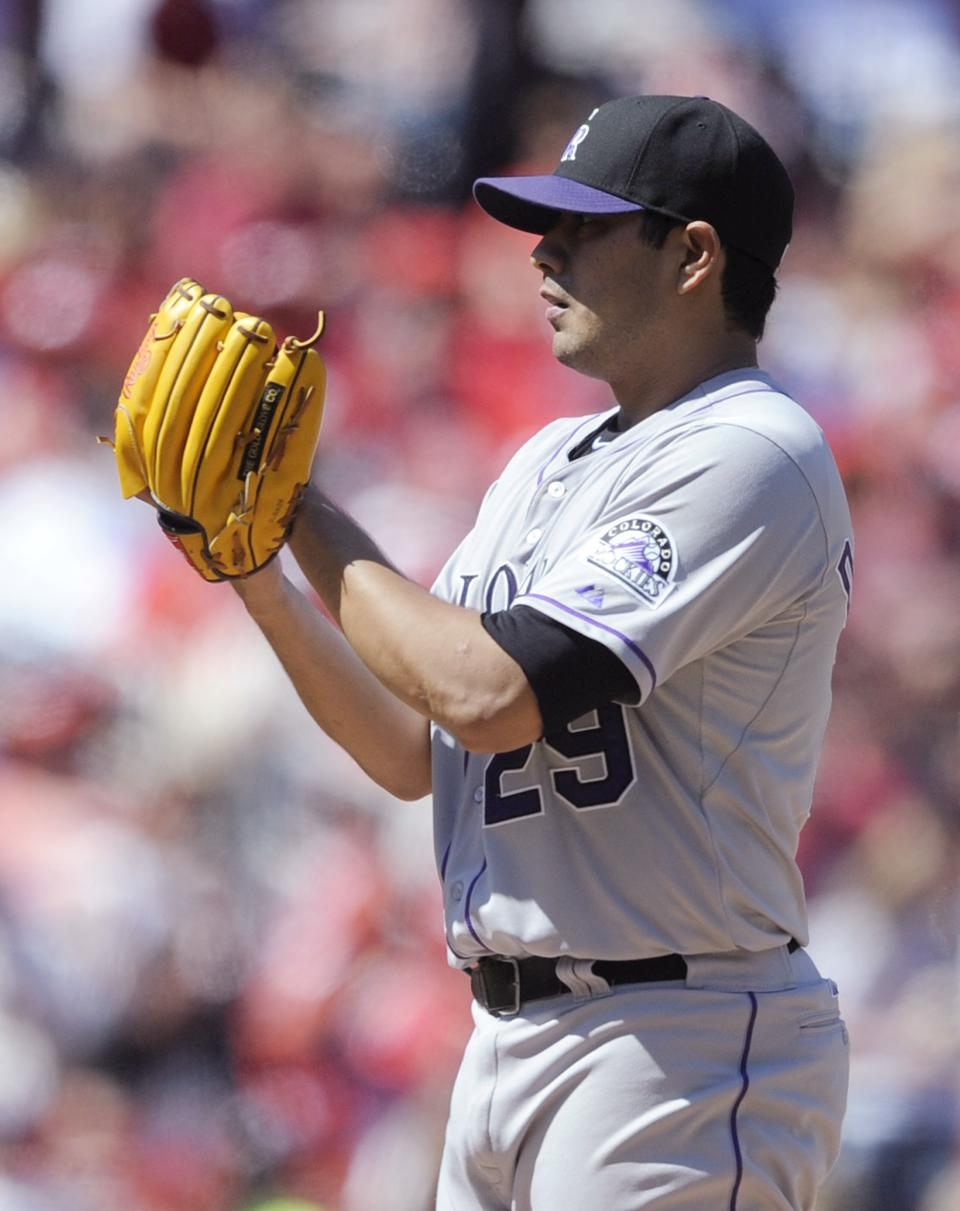 Colorado Rockies' starting pitcher Jorge De La Rosa gets the sign against the St. Louis Cardinals in the sixth inning in the National League MLB baseball game Sunday, May 12, 2013, at Busch Stadium in St. Louis. (AP Photo/Bill Boyce)