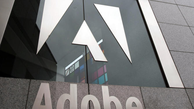 FILE - In this Wednesday, Dec. 13, 2006, file photo, an exterior view of the Adobe headquarters is seen in San Jose, Calif. Adobe announced Monday, May 6, 2013, it is moving to a subscription-based model for the software package it sells to designers, Web developers, video editors and other creative professionals. Adobe Systems Inc. said Monday that it will not release new versions of its Creative Suite software package. Instead, the maker of Photoshop, Illustrator and Acrobat, is shifting focus to Creative Cloud, which makes its software available through a monthly subscription that starts at $50 for an individual. (AP Photo/Paul Sakuma, File)