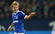 Schalke 04 midfielder Lewis Holtby, seen here in September 2012, has hinted he would one day love to play for a Premier League club ahead of the Royal Blues' Champions League match with Arsenal