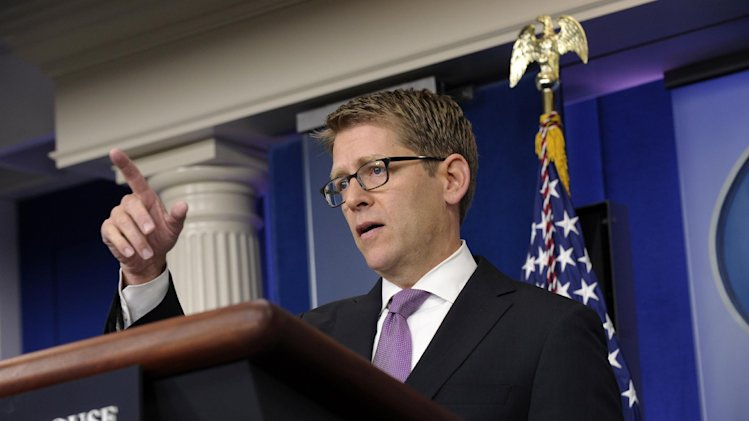 White House press secretary Jay Carney gestures as he speaks during the daily briefing at the White House in Washington, Tuesday, July 23, 2013. Carney was asked about Syria, immigration, the death of veteran White House journalist Helen Thomas and the birth of the new prince. (AP Photo/Susan Walsh)