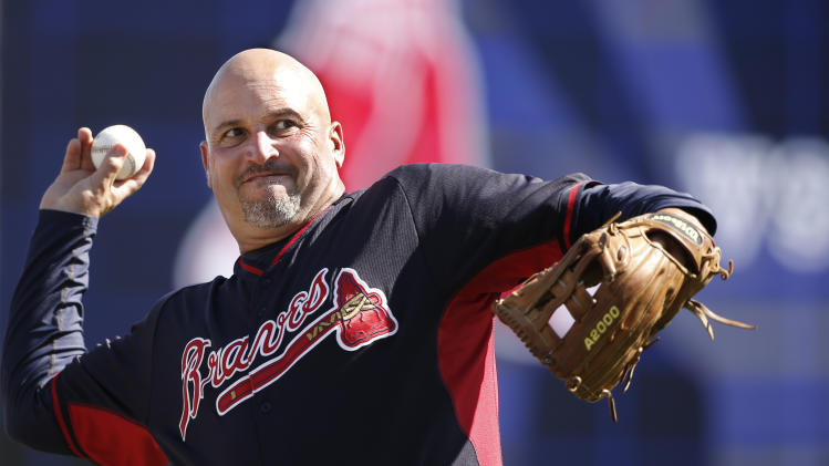 Atlanta Braves manager Fredi Gonzalez throws a before a spring exhibition baseball game in Tampa, Fla., Sunday, March 16, 2014. (AP Photo/Kathy Willens)