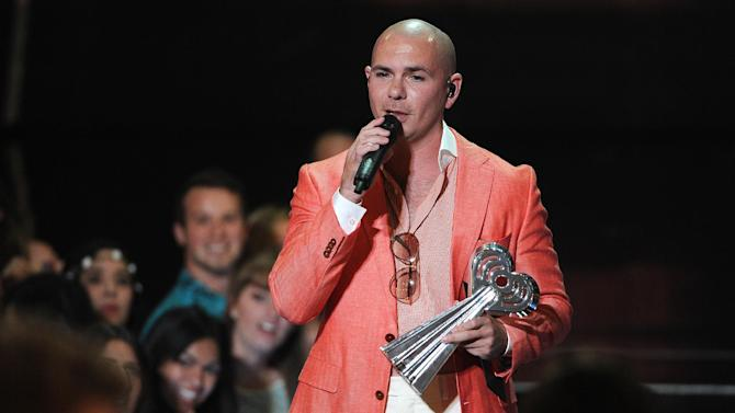 Pitbull presents the award for hip hop/R&B song of the year at the iHeartRadio Music Awards at the Shrine Auditorium on Thursday, May 1, 2014, in Los Angeles. (Photo by Chris Pizzello/Invision/AP)