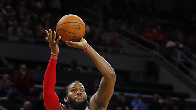 Detroit Pistons forward Greg Monroe (10) shoots against Indiana Pacers center Roy Hibbert (55) in the second half of an NBA basketball game in Auburn Hills, Mich., Friday, Dec. 26, 2014. (AP Photo/Paul Sancya)
