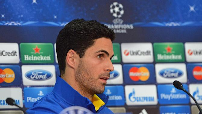Arsenal's Mikel Arteta attends a press conference in Munich, southern Germany, Monday, March 10, 2014, ahead of their round of 16 second leg Champions League soccer match against FC Bayern on Tuesday
