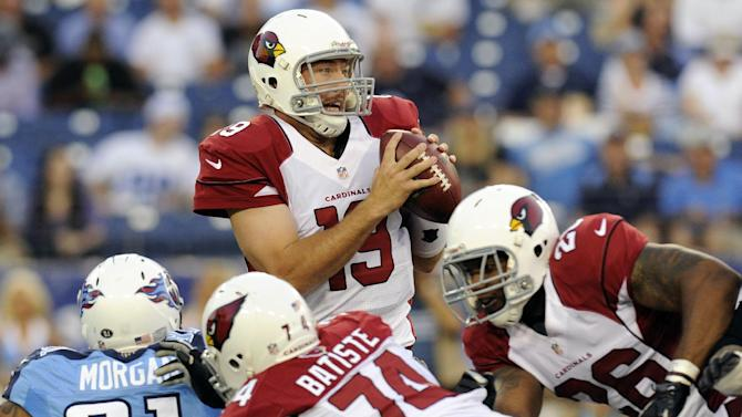 Arizona Cardinals quarterback John Skelton (19) looks for a receiver as he is pressured by Tennessee Titans defensive end Derrick Morgan (91) in the first quarter of an NFL football preseason game on Thursday, Aug. 23, 2012, in Nashville, Tenn. Cardinals offensive guard D'Anthony Batiste (74) and running back Beanie Wells (26) block for Skelton. (AP Photo/Joe Howell)