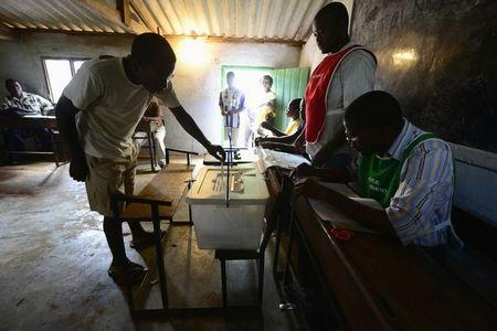 A Mozambican man casts his ballot at a voting station near Gorongosa in central Mozambique