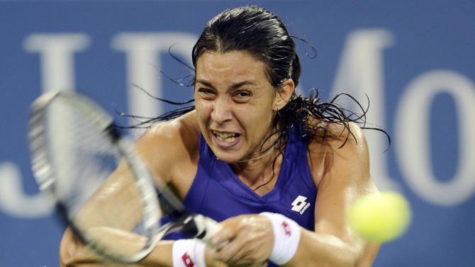 Marion Bartoli, of France, returns a shot to Petra Kvitova, of the Czech Republic, in the fourth round of play at the U.S. Open tennis tournament, Sunday, Sept. 2, 2012, in New York. Bartoli won 1-6, 6-2, 6-0. (AP Photo/Henny Ray Abrams)