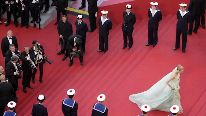 Jury member Diane Kruger, right, walks up the steps of the red carpet during the opening ceremony and screening of Moonrise Kingdom at the 65th international film festival, in Cannes, southern France, Wednesday, May 16, 2012. Kruger is wearing a dress by Versus. (AP Photo/Virginia Mayo, Pool)