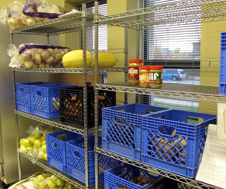 In this Nov. 9, 2011, photo shows the once full peanut butter shelf at the Broad Street Presbyterian Church food pantry in Columbus, Ohio, which started limiting the largest families to two jars instead of three if it's available. (AP Photo/Kantele Franko)