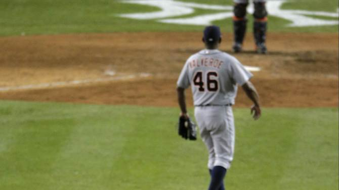 New York Yankees Ichiro Suzuki runs the bases around Detroit Tigers pitcher Jose Valverde after hitting a two-run home run in the month inning of Game 1 of the American League championship series Saturday, Oct. 13, 2012, in New York. (AP Photo/Charlie Riedel)