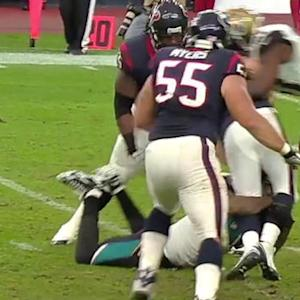 Jacksonville Jaguars defensive end Chris Clemons forces sack fumble