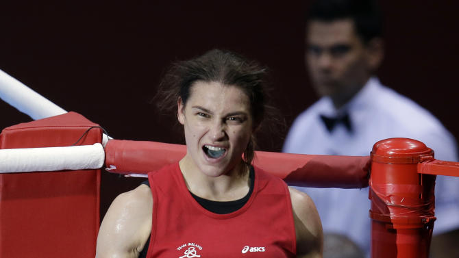 Ireland's Katie Taylor celebrates after defeating Britain's Natasha Jonas in a women's lightweight 60-kg quarterfinal boxing match at the 2012 Summer Olympics, Monday, Aug. 6, 2012, in London. (AP Photo/Mike Groll)