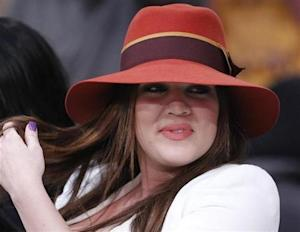 Khloe Kardashian sits courtside in Los Angeles