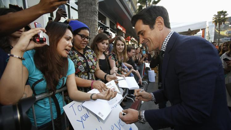 "Cast member Burrell signs autographs at the premiere of ""Muppets Most Wanted"" at El Capitan theatre in Hollywood"