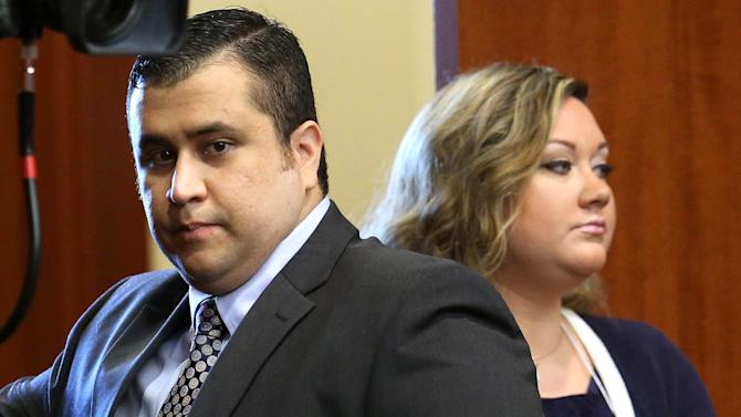 In this June 24, 2013 file photo, George Zimmerman, left, arrives in Seminole circuit court, with his wife Shellie, in Sanford, Fla. Shellie Zimmerman called police on Monday, Sept. 9, 2013, saying her husband threatened her and her dad with a gun. Zimmerman was acquitted in the 2012 shooting death of Trayvon Martin. (AP Photo/Orlando Sentinel, Joe Burbank, Pool, File)