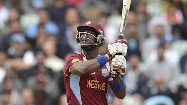 West Indies' Darren Sammy hits a six (Reuters)