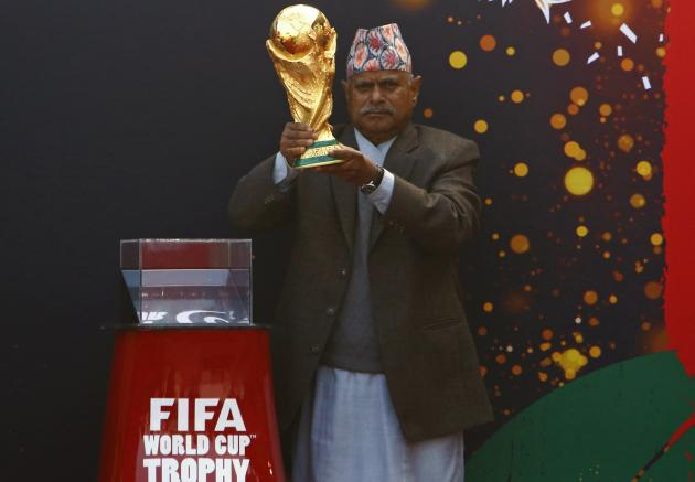 Nepal's President Ram Baran Yadav holds the World Cup trophy during the FIFA World Cup Trophy Tour in Kathmandu