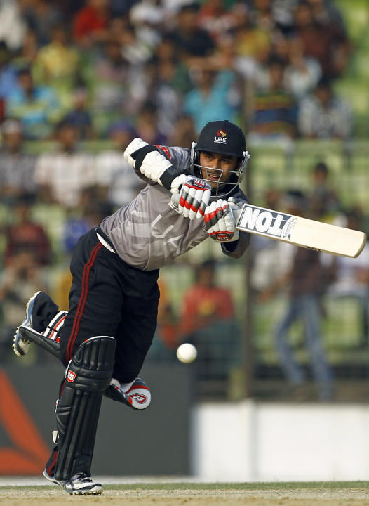 United Arab Emirates' Khurram Khan bats during a warm-up cricket match against Bangladesh ahead of the Twenty20 World Cup Cricket in Fatullah, near Dhaka, Bangladesh, Wednesday, March 12, 2014. (A
