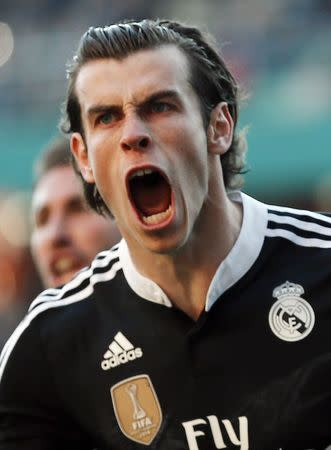 Real Madrid's  Bale celebrates after scoring against Cordoba during their Spanish First Division soccer match at El Arcangel stadium in Cordoba