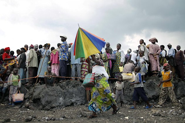 Internally displaced Congolese wait for food to be distributed by WFP at the Mugunga 3 camp outside the eastern Congolese town of Goma Sunday Dec. 2, 2012. Rebels say they will take back Congo&#39;s city of Goma if the government does not agree to negotiate with them by Monday. The M23 rebels completed their withdrawal of the eastern Congo city on Saturday, in compliance with an agreement reached between the rebel group and a regional body. (AP Photo/Jerome Delay)