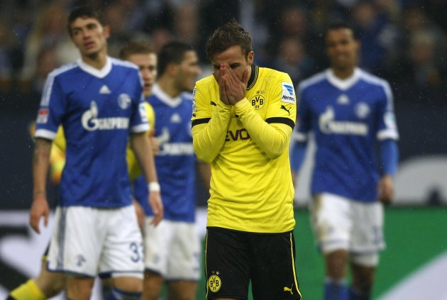 Borussia Dortmund's Goetze reacts during the German first division Bundesliga soccer match against Schalke 04 in Gelsenkirchen