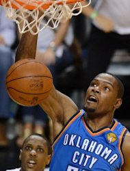 Kevin Durant of the Oklahoma City Thunder scores during the fifth game of the NBA Finals at the American Airlines Arena in Miami, Florida. The Miami Heat won the NBA Finals, defeating the Oklahoma City Thunder 121-106 to capture the best-of-seven championship series 4-1