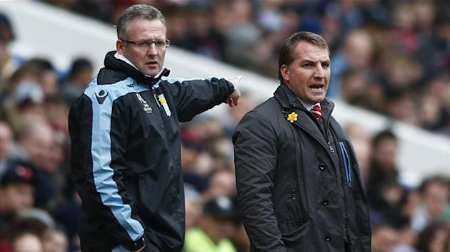 Liverpool's manager Brendan Rodgers (R) and his Aston Villa counterpart Paul Lambert react during their English Premier League soccer match at Villa Park (Reuters)