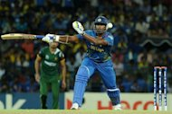 Sri Lankan cricketer Thisara Perera plays a shot during their ICC Twenty20 Cricket World Cup's semi-final match against Pakistan at The R. Premadasa International Cricket Stadium in Colombo. Sri Lanka won by 16 runs