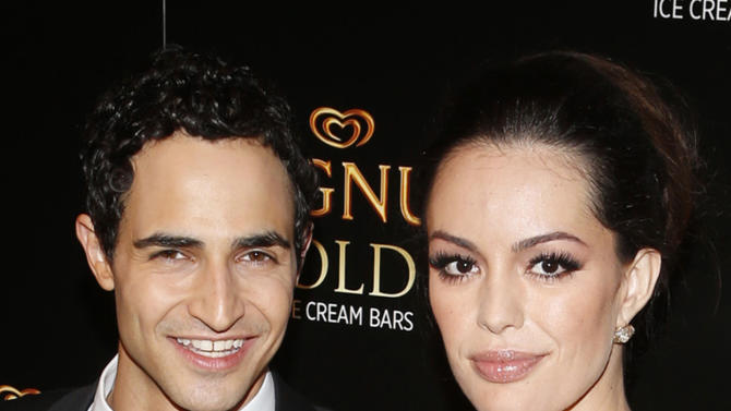 IMAGE DISTRIBUTED FOR MAGNUM - Couture designer Zac Posen, left, and actress Caroline Correa arrive on the gold carpet of the As Good As Gold premiere, a new short film starring Joe Manganiello that celebrates the U.S. arrival of MAGNUM Gold?! Ice Cream. The film debuted during the Tribeca Film Festival Thursday, April 18, 2013 in New York. Visit MagnumIceCream.com for more information  (Photo by Jason DeCrow/Invision for MAGNUM/AP Images)